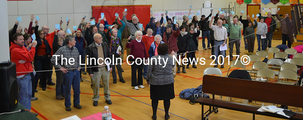 Whitefield residents in favor of adopting an elderly tax deferral ordinance are counted at the annual open town meeting March 19. Whitefield will again vote on the ordinance June 14. (Abigail Adams photo)