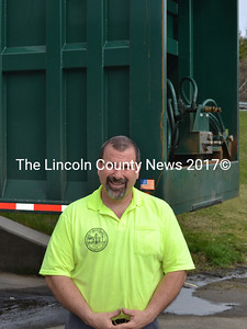 Wiscasset Transfer Station Superintendent Ron Lear stands in front of a trailer used to haul solid waste to the Penobscot Energy Recovery Co. facility in Orrington on Friday, April 22. Lear is recommending that the town send solid waste to Fiberight LLC's planned facility in Hampden beginning in 2018. (Abigail Adams photo)