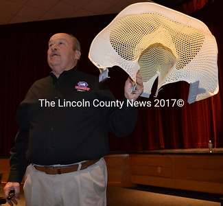 Brian McQueen holds a mask from his cancer treatment during his presentation to Knox and Lincoln County firefighters at Medomak Valley High School in Waldoboro on Tuesday, April 26. (J.W. Oliver photo)
