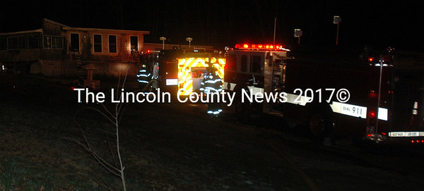 Firefighters respond to a fire in a home on Wagner Bridge Road in Waldoboro. (Alexander Violo photo)