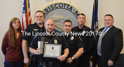 Sgt. Jason Warlick (center) received the Damariscotta Police Department's 2015 Officer of the Year Award on Wednesday, April 20. From left: Damariscotta Police Department Administrative Assistant Joanna Kenefick, Officer Jim Dotson, Warlick, Officer Kyle Sylvester, Officer Erick Halpin, and Chief Ron Young. (Maia Zewert photo)