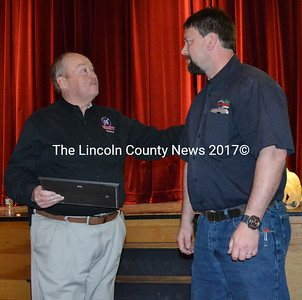 Brian McQueen (left) accepts a certificate of appreciation from Lincoln County Fire Chiefs Association President Neil Kimball after McQueen's presentation about the growing prevalence of cancer among firefighters. (J.W. Oliver photo)