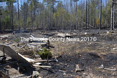 The remains of an unpermitted burn rekindled, grew out of control, and burned about 2 1/2 acres at 664 Benner Road in Bristol the afternoon of Thursday, April 21. Firefighters from Bristol and Damariscotta spent 4 1/2 hours on scene extinguishing the fire, monitoring for hot spots, and cleaning up, Bristol Fire Chief Paul Leeman said. (Maia Zewert photo)