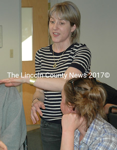 Waldoboro Planning and Development Director Emily Reinholt confers with a work group during the A.D. Gray building discussion in Waldoboro. (Alexander Violo photo)