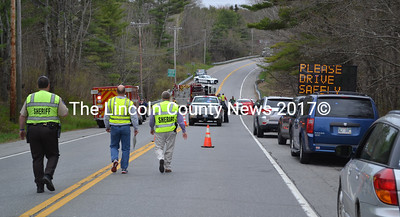 From left, Lincoln County Sheriff's Office Lt. Rand Maker, accident reconstructionist Sgt. Jason Nein, and Sheriff Todd Brackett work at the scene of a fatal accident just north of the Wiscasset-Woolwich line Friday, May 13. (Abigail Adams photo)