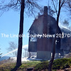 Firefighters extinguish flames in the shell of a cottage on John's Bay in South Bristol on Saturday, May 14. (J.W. Oliver photo)