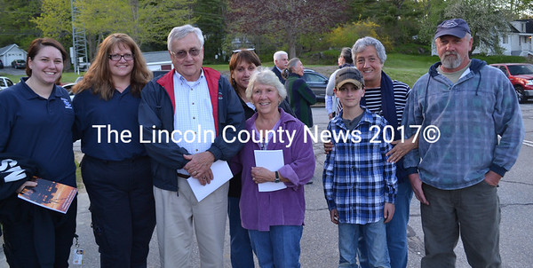 Three generations of the Blagdon family gather at the Wiscasset Board of Selectmen's Tuesday, May 17 meeting to witness the dedication of the 2015 town report to Gert and John Blagdon, founding members of the Wiscasset Ambulance Service. From left: Megan and Wendy Williams, John, Bonnie, Gertrude, Chance, and Janice Blagdon, and John Blagdon III. (Abigail Adams photo)