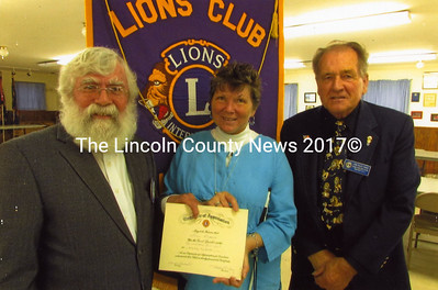 From left: King Lion Frank Daly, speaker Leona McKenna, and Clinton Lion Rolfe Frost.