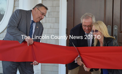 Gov. Paul LePage holds the ribbon as Boothbay Harbor Country Club owner Paul Coulombe and his wife Giselaine cut the ribbon to the clubhouse May 11. (Maia Zewert photo)