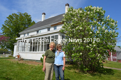 IInn Along the Way Vice President Suzy Hallett (left) and President Sherry Flint stand in front of the house on the Chapman Farm property at 741 Main St. in Damariscotta. The organization will hold a spring gathering Saturday, May 28. (Maia Zewert photo)