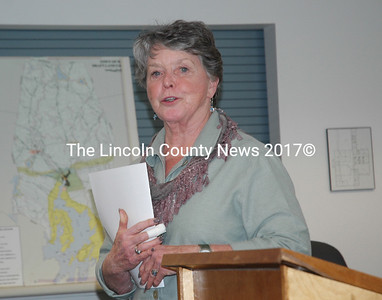 Waldoboro Selectman Jann Minzy speaks on the dedication of Waldoboro's 2015 annual report to the late Ronald Dolloff. (Alexander Violo photo)