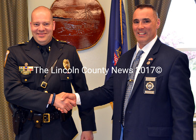 Wiscasset Police Chief Jeffery Lange (left) shakes hands with Rick Belanger after the chief's swearing-in ceremony. Belanger, a friend and former colleague, pinned the chief's shield on his chest. (Charlotte Boynton photo)