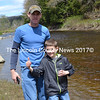 Donnie (left) and Ryan Clark release Atlantic salmon into the Sheepscot River as part of an Edgecomb Eddy School field trip May 17. (Abigail Adams photo)