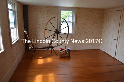 A spinning wheel sits in one of the bedrooms in the home on the Chapman Farm property. Inn Along the Way Vice President Suzy Hallett said the bedrooms could become office space in the future. (Maia Zewert photo)