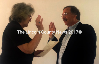 Edgecomb Town Clerk Claudia Coffin swears in new Selectman Ted Hugger after Edgecomb's annual town meeting Saturday, May 21. (Abigail Adams photo)