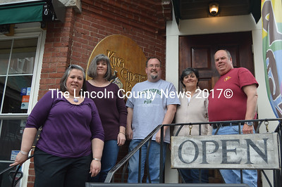 The current owners of King Eider's Pub stand in front of the restaurant in May 2016, 20 years after the pub originally opened. From left: Cynthia Weiss, Melissa Organ, Jed Weiss, Sarah Maurer, and Todd Maurer. (Maia Zewert photo)