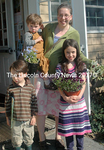 Jessica Koubek and her children Isaac, Noah, and Lydia found books, plants, and fun at the 25th annual Bremen Library plant sale on Saturday, May 21. (Eleanor Cade Busby photo)