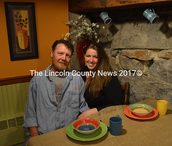 Alex Brown and Christine Schweighauser sit in the future home of Cocinas Underground, a year-round restaurant Schweighauser plans to open in downtown Damariscotta in early June. Schweighauser also owns and operates The Cook's Corner at 603 Main St. in Damariscotta. (Maia Zewert photo)