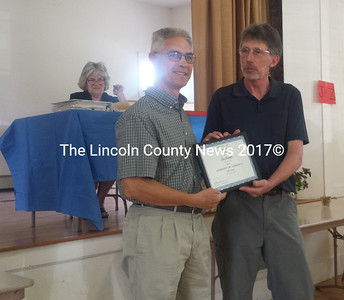 Selectman Mike Smith (right) presents Kim Bachelder with the Spirit of America Award at Edgecomb's annual town meeting Saturday, May 21. (Abigail Adams photo)