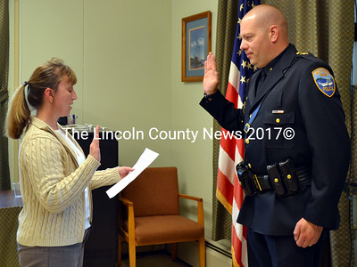 Wiscasset Town Clerk Linda Perry administers the oath of office to Wiscasset Police Chief Jeffery Lange at the town office Monday, May 23. (Charlotte Boynton photo)