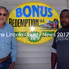 Dan Goldenson (left) and Tony Thurman stand next to the sign for Bonus Redemption LLC in Waldoboro on Monday, June 20. Goldenson recently purchased the redemption center, and Thurman manages it. (J.W. Oliver photo)