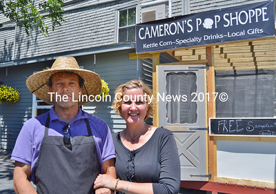 Wade Cameron Ingham and Jennifer Ingham stand in front of their new store, Cameron's Pop Shoppe, at 49 Main St. in Wiscasset on June 15. (Haley Bascom photo)