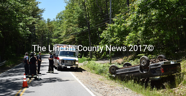 A Dodge Dakota pickup truck rests on its roof in a ditch alongside Route 144 in Wiscasset on Thursday, June 16. The driver and sole occupant of the vehicle was not hurt. (J.W. Oliver photo)