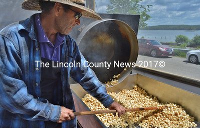 Wade Cameron Ingham makes the all-natural popcorn on the front patio, where customers can watch and test new flavors. (Haley Bascom photo)