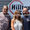 From left: Dan Goldenson, Jane Gravel, and Gary Gravel stand outside Hilltop Stop in Damariscotta on Friday, June 24. Goldenson is buying the property from the Gravels, but Gary Gravel will continue to run the business. (J.W. Oliver photo)
