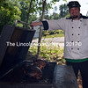 Travis Benner tends to a pork butt on the smoker. (J.W. Oliver photo)