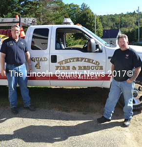 Kings Mills Volunteer Fire Department Assocation member Lynn Talacko (left) and association President Jeff Newell stand in front of a truck purchased by the association last year. The association will host an open house Sunday, Sept. 25. (Abigail Adams photo)