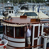 George McEvoy, captain of the Nellie G II, waves to the veterans he took on a cruise around Boothbay Harbor on Thursday, Sept. 22. (Charlotte Boynton photo)