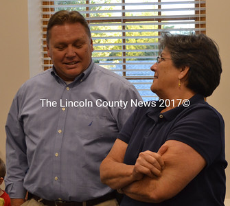 Damariscotta Police Chief Ron Young and Damariscotta Board of Selectmen Chair Robin Mayer talk during a volunteer reception Wednesday, Sept. 21. (Maia Zewert photo)