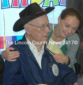 Woody Verge gets a birthday hug from Shannyn Soule at Moody's Diner the morning of Monday, Sept. 26. (Alexander Violo photo)