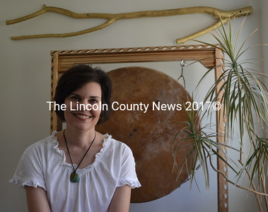 Emily Sabino, of Newcastle, offers intuitive readings and healing in her 13 Pleasant St. home. During a session, Sabino uses various techniques and tools to assist with the healing process, including the large drum behind her. (Maia Zewert photo)