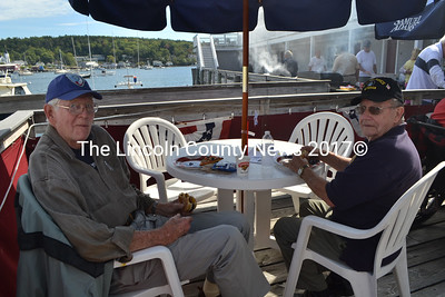 "Boothbay Harbor veteran Palmer Payne (left) gave the veterans cruise high praise, saying the event was ""magnificent"" and the planning and generosity of the event was breathtaking. Payne will be a guest speaker at a lobstermen's appreciation dinner at the Boothbay American Legion post Oct. 15. Veteran Arthur Richardson (right) agreed that the cruise and the generosity of the volunteers was wonderful, and very much appreciated by the veterans. (Charlotte Boynton photo)"