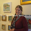 Saltwater Artists Gallery member Alison Dibble stands before a wall featuring her oil and watercolor paintings at the cooperative gallery located in New Harbor. (Christine LaPado-Breglia photo)