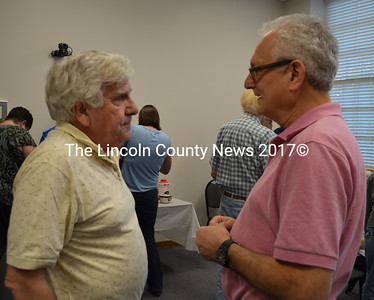 Dick McLean (left) chats with Damariscotta Selectman Ronn Orenstein during a reception for the town's volunteers Wednesday, Sept. 21. (Maia Zewert photo)