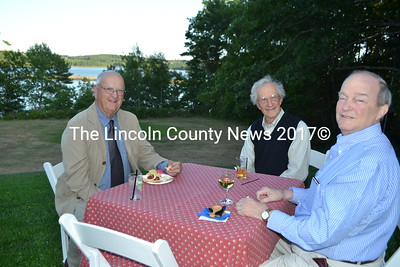 From left: William Sutter, Tom Eichler, and William Gemmill enjoy the view of the Sheepscot River from the Marianmade Farm during the Bands for Books fundraiser Sunday, Sept. 4. (Charlotte Boynton photo)