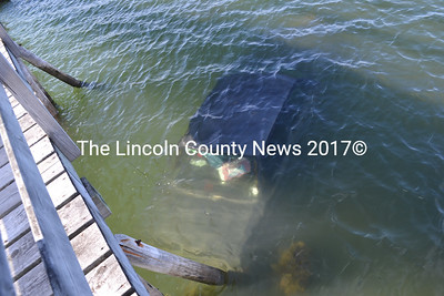 A car is completely submerged after going into the Pemaquid River at Hanna's Landing in Bristol on Monday, Sept. 5. The owner of the vehicle, Ralph Ferguson, was not in the car when it went into the water, according to Lincoln County Sheriff's Deputy 1st Class Brian Collamore. (Maia Zewert photo)