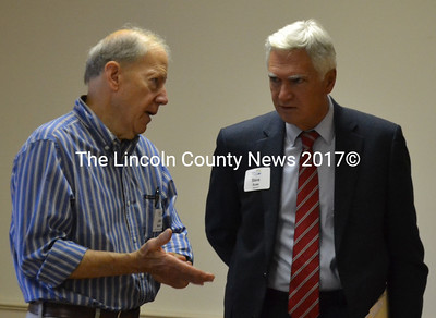 Maine Community Foundation President and CEO Steven Rowe (right) speaks with John Morris, who chairs the committee that oversees the foundation's Lincoln County fund, during a community conversation at The Second Congregational Church in Newcastle on Thursday, Sept. 1. (Maia Zewert photo)