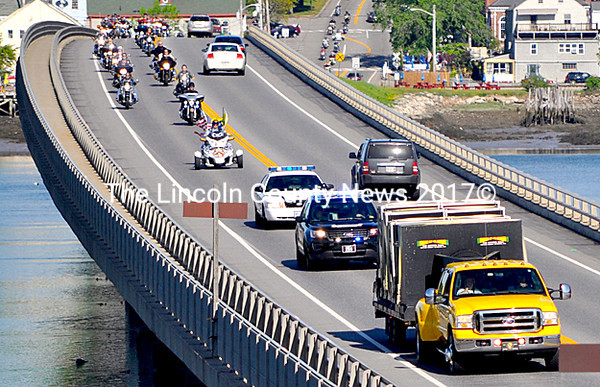 Law enforcement and motorcyclists escort The Moving Wall across the Donald E. Davey Bridge from Wiscasset to Edgecomb on May 25. The half-size replica of the Vietnam Veterans Memorial was on its way to the Knox Museum in Thomaston for Memorial Day weekend. (Photo courtesy Kim Traina)