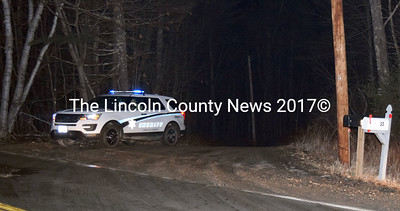 A Lincoln County Sheriff's Office vehicle waits at the end of River Bend Road in Waldoboro shortly after 2 a.m., Sunday, Jan. 22. The gravel road off Winslows Mills Road was closed after a police-involved shooting earlier Sunday. (J.W. Oliver photo)