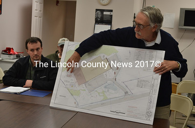 Architect George Parker (right) describes plans for an expansion of the Renys distribution center as Adam Reny looks on during a Newcastle Planning Board meeting Thursday, Jan. 19. (Maia Zewert photo)
