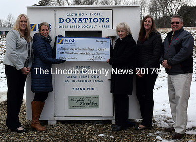Representatives of the First National Bank present a $3,750 check for the dropoff bin at the Lincoln County Neighbor to Neighbor Clothing Exchange in Waldoboro on Thursday, Feb. 2. From left: Sarah Cowan, regional manager for Lincoln County; Leah Nickerson, manager of the Waldoboro branch; Bonnie Lash, mortgage lender at the Waldoboro branch; Shanna Castner, assistant branch manager; and Lincoln County Sheriff Todd Brackett. (J.W. Oliver photo)