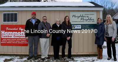Supporters of the Lincoln County Neighbor to Neighbor Clothing Exchange gather during opening week at the new Waldoboro location. From left: Ted Perkins, manager of the Hammond Lumber Co. locations in Boothbay Harbor, Damariscotta, and Pemaquid; Lincoln County Sheriff Todd Brackett; Bonnie Lash, mortgage lender at the First National Bank's Waldoboro branch; Shanna Castner, assistant branch manager; Leah Nickerson, branch manager; and Sarah Cowan, regional manager for Lincoln County. (J.W. Oliver photo)