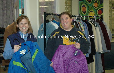 Susan Jones (left) and Kali Martin display some of the items available at the clothes closet at Medomak Valley High School in Waldoboro. (Alexander Violo photo)