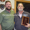 Outgoing Lincoln County Fire Chiefs Association President Neil Kimball (left) presents a plaque to former Lincoln County Communications and Emergency Management Agency Director Tod Hartung during the association's meeting at the Boothbay Fire Department on Wednesday, Feb. 22. The plaque recognizes and thanks Hartung for his dedicated service. (J.W. Oliver photo)