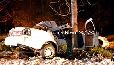 A Mercury Grand Marquis is pulled from the scene of an accident on Route 32 in Waldoboro the evening of Friday, Dec. 30. (Abigail Adams photo)