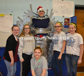 From left: Great Salt Bay Community School eighth-graders Kady Goode, Brittni Hartley, Tasha Anderson, Shea Clifford, and Kaylee Poland pose with GSB Principal Kim Schaff. Students and faculty paid to duct tape Schaff to the wall, with all proceeds from the event going to the Skiff family. (Maia Zewert photo)
